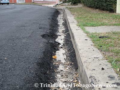 On the other side of the street the edge of the newly paved road has also created a deep slipper drain that cars can slip into thereby causing drivers to lose control.