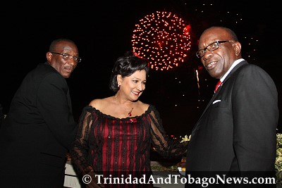 Minister of Arts and Multiculturalism Winston 'Gypsy' Peters, Prime Minister Kamla Persad-Bissessar and Minister of Works and Transport Jack Warner on the Hilton rooftop observing Independence Day fireworks