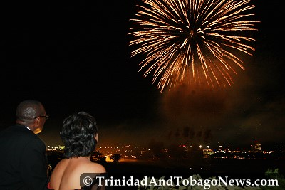 Minister of Arts and Multiculturalism Winston 'Gypsy' Peters and Prime Minister Kamla Persad-Bissessar observe the Independence fireworks display from the Hilton rooftop