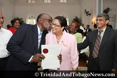 UNC Chairman and Chief Whip Jack Warner congratulates New Opposition Leader Kamla Persad-Bissessar