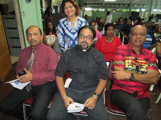 Special Guests PE Kowlessar, Rev Sieunarine and Elder Mr Charles Mahabir with School Principal, Mrs Jenny Kowlessar (Back) At the Xmas Function