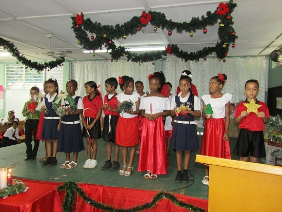The Twelve Symbols of Xmas displayed by students with the Star of David at right