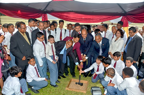 Minister of Education Tim Gopeesingh turning the sod to start $15m expansion at Hillview
