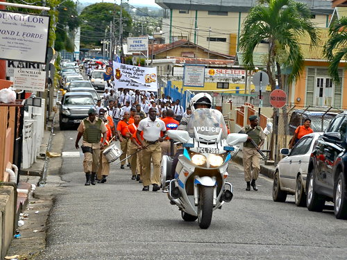 Marchers on Cochrane Street, Tunapuna
