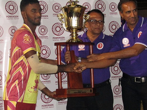 HVC Skipper Navin Bidaissie (left) Receiving the Championship Trophy from Powergen and Secondary Schools Officials after the match