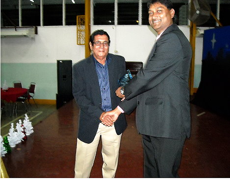 Ramlogan Mahabir (left) Receiving his Plaque from The President of the Hillview Old Boys Association, Mr.Peter Machikan