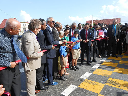 Prime Minister Kamla Persad Bissessar cutting the ribbon to declare the new SMR  formally open
