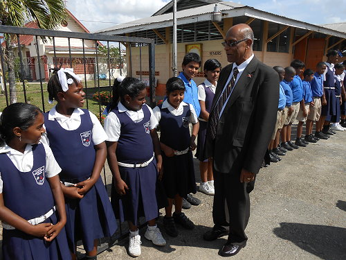 Minister Rambachan meeting pupils of Caroni Presbyterian School that will be rebuilt in May 2015
