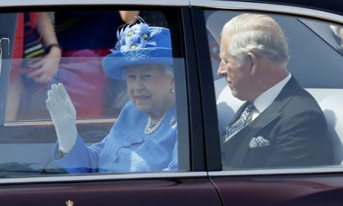 Her Majesty the Queen with Prince Charles on her way to Parliament in her Bentley