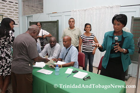 Residents chat with members of the head table while one member addresses fustrated residents