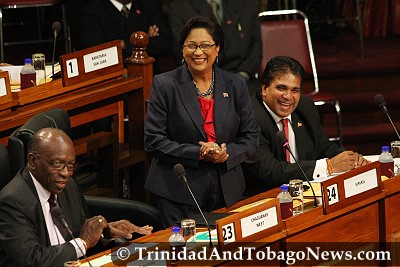 Prime Minister Kamla Persad-Bissessar, Works and Transport Minister Jack Warner and leader of government business Roodal Moonila share a laugh in Parliament - June 25, 2010