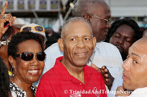M.P. for San Fernando East and former Prime Minister Patrick Manning and his wife Hazel Manning walkinkg through the Calypso Fiesta 2013 crowd