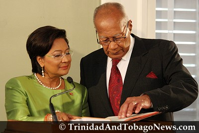 Kamla Persad-Bissessar is sworn in by President George Maxwell Richards as the first female Prime Minister of Trinidad and Tobago