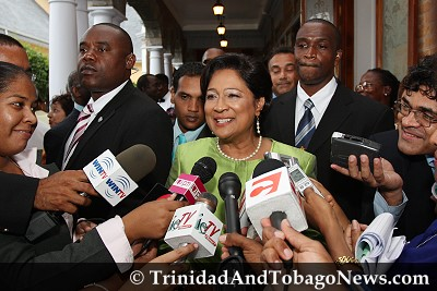 Prime Minister Kamla Persad-Bissessar talks with the media
