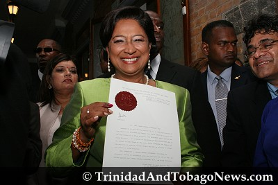 Kamla Persad-Bissessar is sworn in as the first female Prime Minister of Trinidad and Tobago