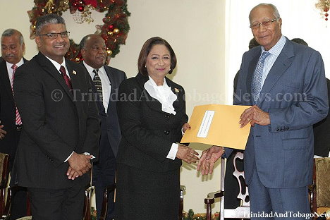 Prime Minister Kamla Persad-Bissessar receives her Senior Counsel appointment from President George Maxwell Richards