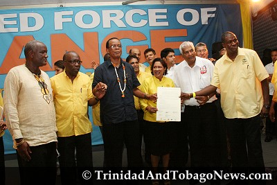 United National Congress (UNC) leader Kamla Persad-Bissessar holds up the Declaration of Political Unity signed at Charlie King Junction, Fyzabad. LEFT: NJAC representative Nyahuma Obika, UNC chairman Jack Warner, chairman of the Movement for Social Justice, Errol McLeod, Congress of the People (COP) political leader Winston Dookeran and Ashworth Jack, leader of the Tobago Organisation of the People (TOP)