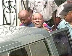 Kareem Ibrahim being taken from court