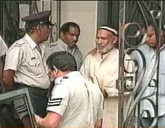 Abdul Kadir being taken from court